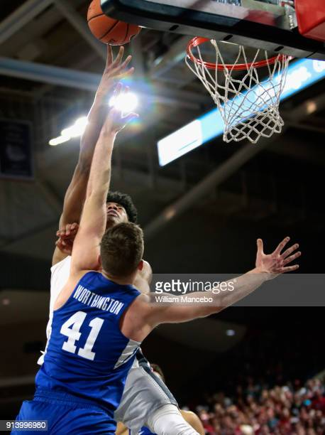 Rui Hachimura of the Gonzaga Bulldogs puts up a shot against Luke Worthington of the BYU Cougars in the second half at McCarthey Athletic Center on...