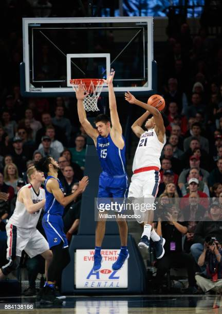 Rui Hachimura of the Gonzaga Bulldogs puts up a shot against Martin Kaampelj of the Creighton Bluejays in the second half at McCarthey Athletic...