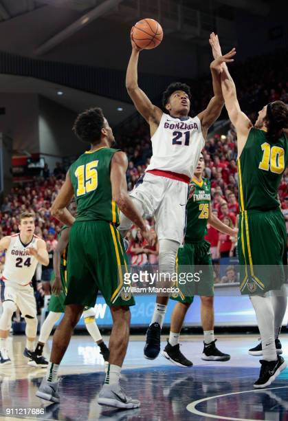 Rui Hachimura of the Gonzaga Bulldogs puts up a shot against Nate Renfro and Matt McCarthy of the San Francisco Dons in the second half at McCarthey...