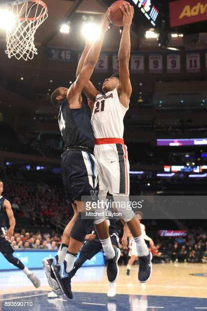 Rui Hachimura of the Gonzaga Bulldogs takes a shot over Omari Spellman of the Villanova Wildcats during the Jimmy V Classic college basketball game...