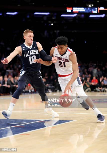 Rui Hachimura of the Gonzaga Bulldogs works against Donte DiVincenzo of the Villanova Wildcats in the first half during their game at Madison Square...