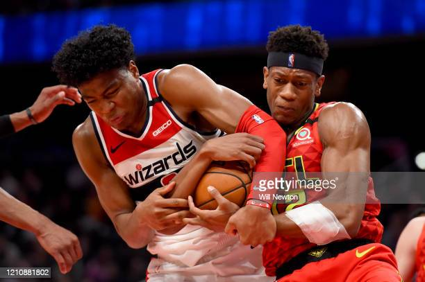 Rui Hachimura of the Washington Wizards and De'Andre Hunter of the Atlanta Hawks battle for possession during the second half at Capital One Arena on...