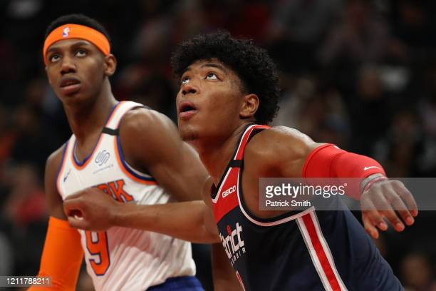 Rui Hachimura of the Washington Wizards and RJ Barrett of the New York Knicks look on during the first half at Capital One Arena on March 10 2020 in...