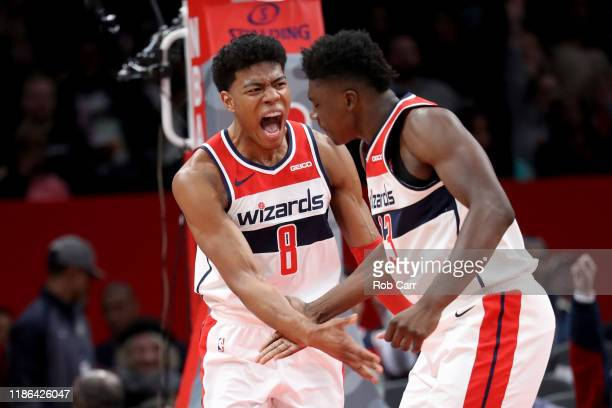 Rui Hachimura of the Washington Wizards celebrates with Thomas Bryant after scoring against the Cleveland Cavaliers in the second half at Capital One...
