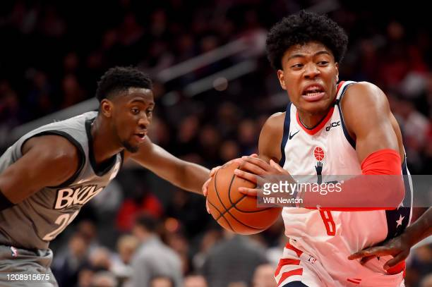 Rui Hachimura of the Washington Wizards dribbles in front of Caris LeVert of the Brooklyn Nets during the first half at Capital One Arena on February...