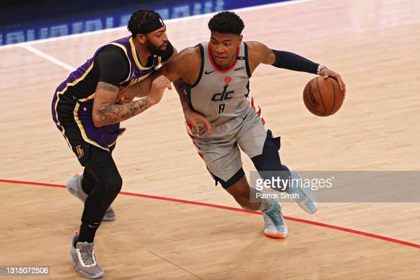 Rui Hachimura of the Washington Wizards dribbles past Anthony Davis of the Los Angeles Lakers during the first half at Capital One Arena on April 28,...