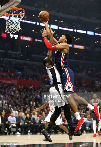 Rui Hachimura of the Washington Wizards dunks the ball as Patrick Beverley of the Los Angeles Clippers defends during the first half at Staples...