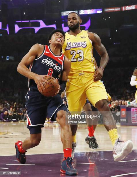Rui Hachimura of the Washington Wizards goes for the basket against LeBron James of the Los Angeles Lakers in November 2019 in Los Angeles