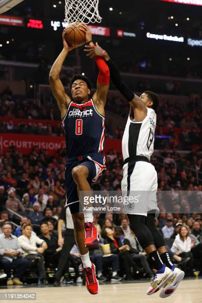 Rui Hachimura of the Washington Wizards goes up for a dunk as Paul George of the Los Angeles Clippers defends during the first half at Staples Center...