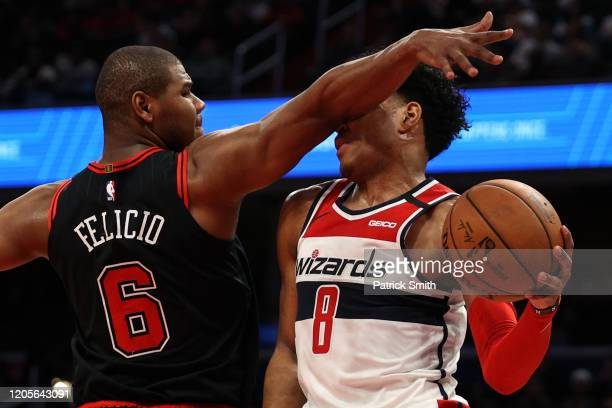 Rui Hachimura of the Washington Wizards is fouled by Cristiano Felicio of the Chicago Bulls during the second half at Capital One Arena on February...