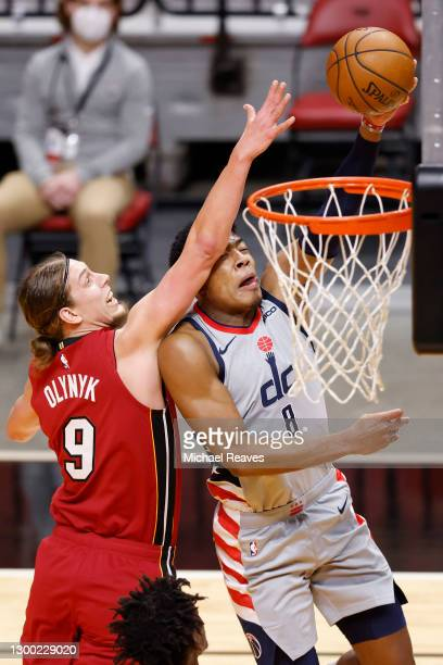 Rui Hachimura of the Washington Wizards is fouled on a layup by Kelly Olynyk of the Miami Heat during the first quarter at American Airlines Arena on...