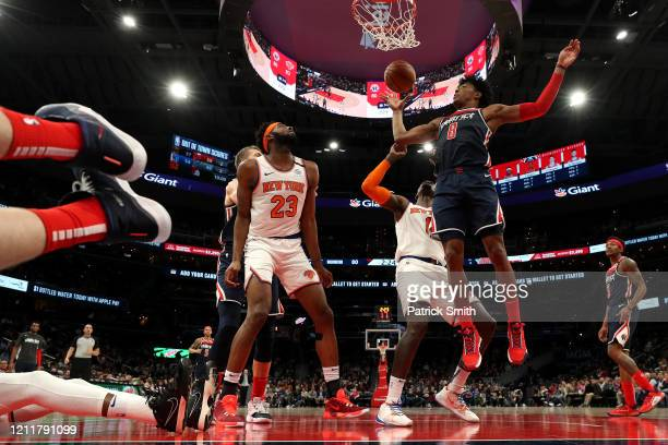 Rui Hachimura of the Washington Wizards rebounds in front of Mitchell Robinson of the New York Knicks at Capital One Arena on March 10, 2020 in...