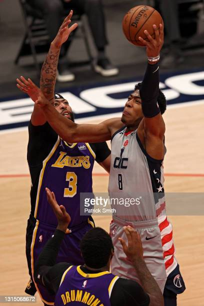 Rui Hachimura of the Washington Wizards shoots in front of Anthony Davis of the Los Angeles Lakers during the first half at Capital One Arena on...
