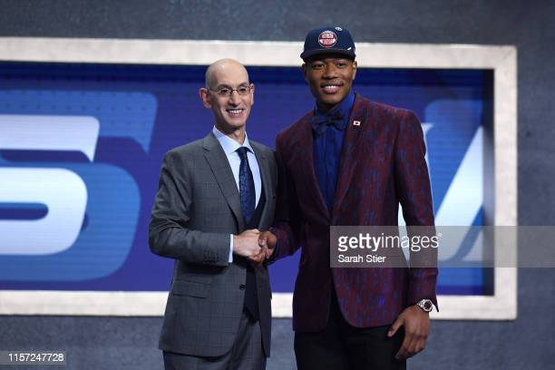 Rui Hachimura poses with NBA Commissioner Adam Silver after being drafted with the ninth overall pick by the Washington Wizards during the 2019 NBA...