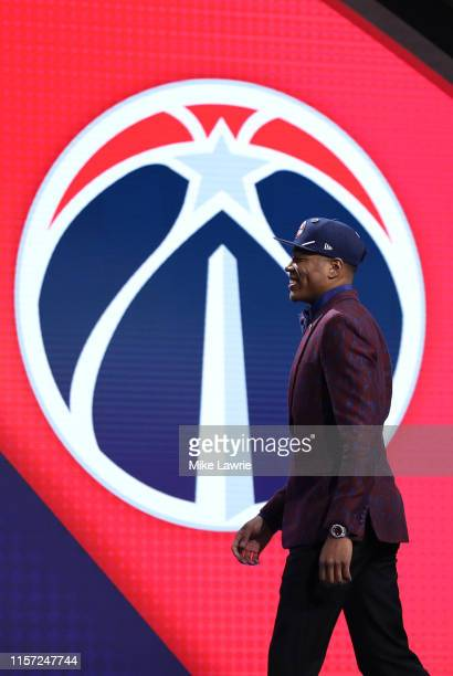 Rui Hachimura walks on stage after being drafted with the ninth overall pick by the Washington Wizards during the 2019 NBA Draft at the Barclays...