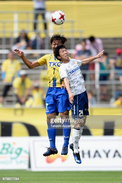 Rui Komatsu of Giravanz Kitakyushu and Kazunori Kan of Tochigi SC compete for the ball during the J.League J3 match between Tochigi SC and Giravanz...