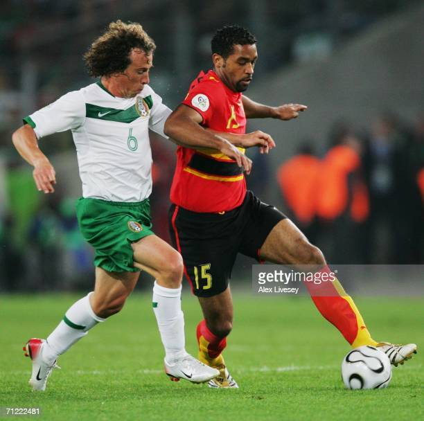 Rui Marques of Angola is pursued by Gerardo Torrado of Mexico during the FIFA World Cup Germany 2006 Group D match between Mexico and Angola played...