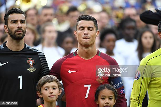 Rui Patricio and Cristiano Ronaldo of Portugal during the European Championship Final between Portugal and France at Stade de France on July 10 2016...