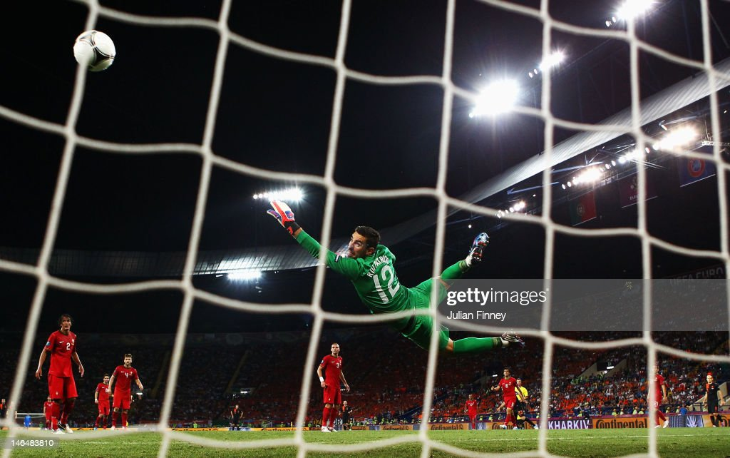 Rui Patricio of Portugal dives as he attempts to make a save during the UEFA EURO 2012 group B match between Portugal and Netherlands at Metalist Stadium on June 17, 2012 in Kharkov, Ukraine.