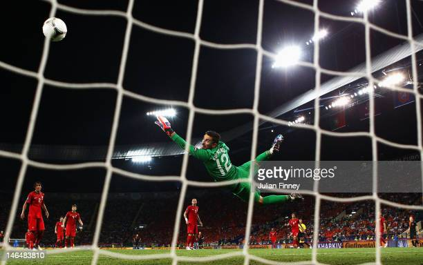 Rui Patricio of Portugal dives as he attempts to make a save during the UEFA EURO 2012 group B match between Portugal and Netherlands at Metalist...