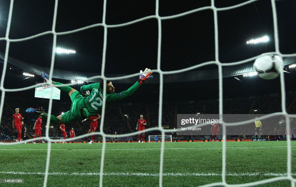 Rui Patricio of Portugal dives as he attempts to stop Rafael van der Vaart (not pictured) of Netherlands scoring the opening goal past during the UEFA EURO 2012 group B match between Portugal and Netherlands at Metalist Stadium on June 17, 2012 in Kharkov, Ukraine.