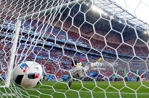 Rui Patricio of Portugal dives in vain as Balazs Dzsudzsak of Hungary scores his team's second goal during the UEFA EURO 2016 Group F match between...