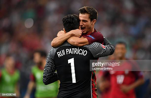 Rui Patricio of Portugal is congratulated by his team mate Cedric Soares after their team's win through the penalty shootout in the UEFA EURO 2016...