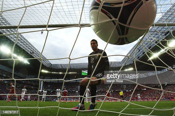 Rui Patricio of Portugal looks on as Nicklas Bendtner of Denmark scores their first goal during the UEFA EURO 2012 group B match between Denmark and...