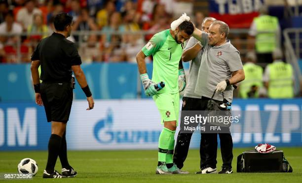 Rui Patricio of Portugal receives treatment during the 2018 FIFA World Cup Russia group B match between Iran and Portugal at Mordovia Arena on June...