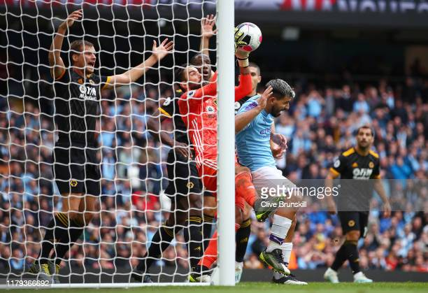 Rui Patricio of Wolverhampton Wanderers catches the ball under pressure from Sergio Aguero of Manchester City during the Premier League match between...