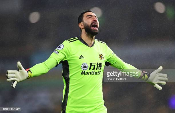 Rui Patricio of Wolverhampton Wanderers celebrates after team mate Joao Moutinho scores their side's second goal during the Premier League match...