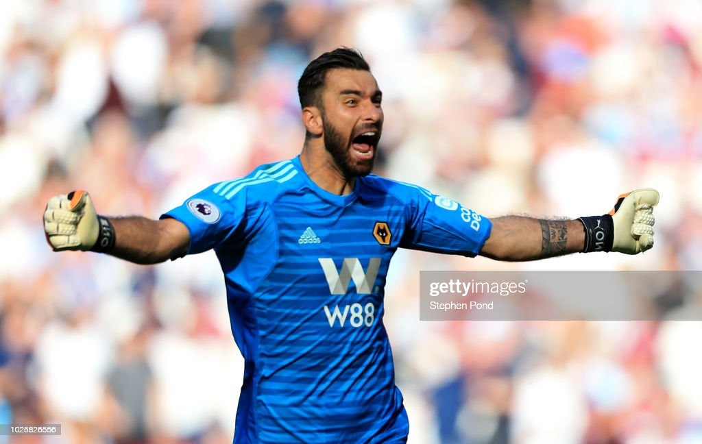 Rui Patricio of Wolverhampton Wanderers celebrates after teammate Adama Traore scores their team's first goal during the Premier League match between West Ham United and Wolverhampton Wanderers at London Stadium on September 1, 2018 in London, United Kingdom.