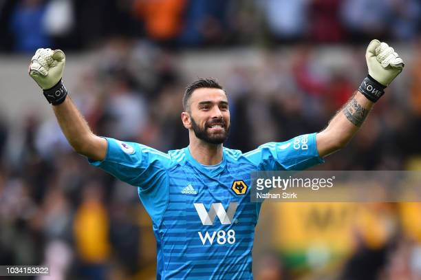 Rui Patricio of Wolverhampton Wanderers celebrates after teammate Raul Jimenez scores their teams first goal during the Premier League match between...