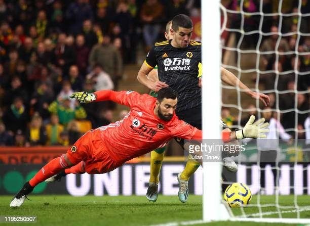 Rui Patricio of Wolverhampton Wanderers dives for the ball during the Premier League match between Norwich City and Wolverhampton Wanderers at Carrow...