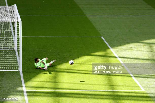 Rui Patricio of Wolverhampton Wanderers dives to attempt to save a shot during the Premier League match between Tottenham Hotspur and Wolverhampton...