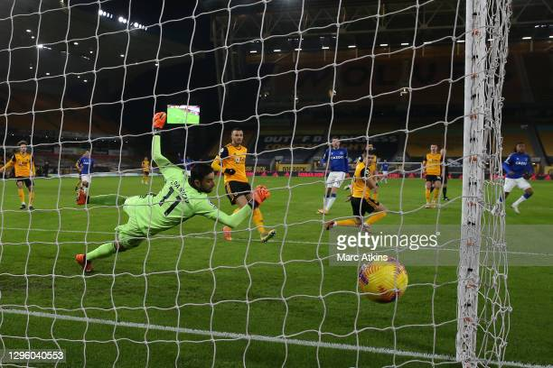 Rui Patricio of Wolverhampton Wanderers fails to save as Alex Iwobi of Everton scores his team's first goal during the Premier League match between...