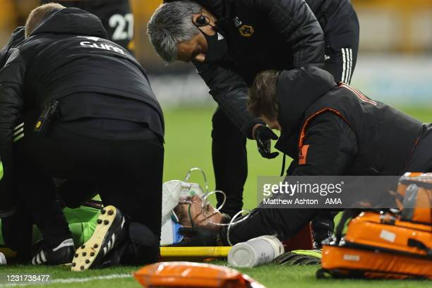 Rui Patricio of Wolverhampton Wanderers is placed on a stretcher during the Premier League match between Wolverhampton Wanderers and Liverpool at...