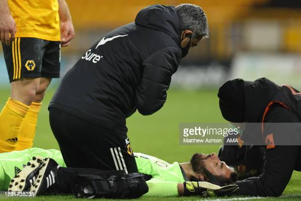 Rui Patricio of Wolverhampton Wanderers lays on the grass after a collision during the Premier League match between Wolverhampton Wanderers and...