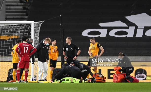 Rui Patricio of Wolverhampton Wanderers receives medical treatment during the Premier League match between Wolverhampton Wanderers and Liverpool at...