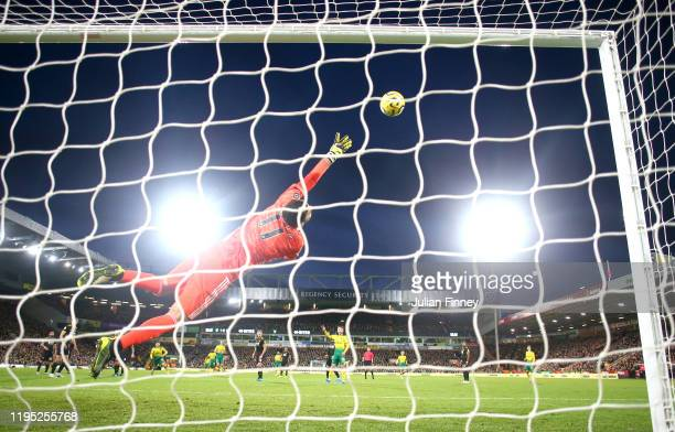 Rui Patricio of Wolverhampton Wanderers stretches as he attempts to make a save during the Premier League match between Norwich City and...