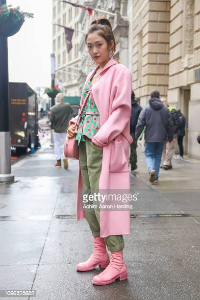 Rui Rui is seen wearing a pink coat and a pink Kate Spade bag on the street during New York Fashion Week on February 8 2019 in New York City