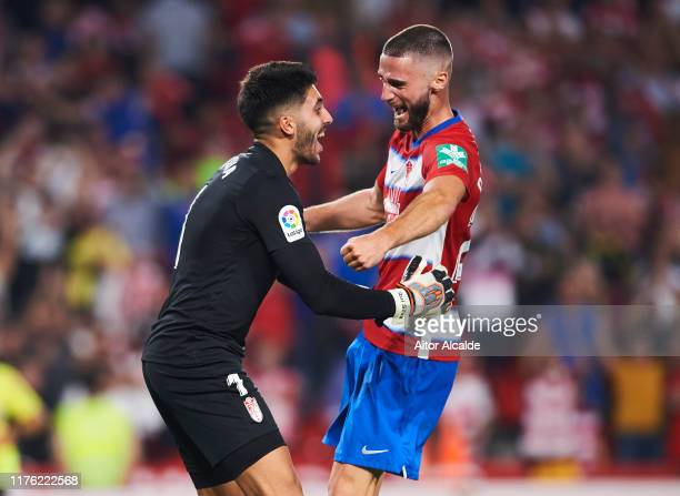 Rui Silva of Granada CF and Domingos Duarte of Granada CF celebrates after wining the match during the Liga match between Granada CF and FC Barcelona...
