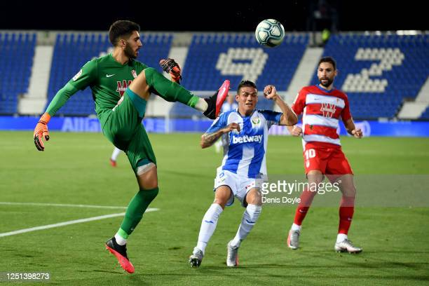 Rui Silva of Granada clears from Jonathan Silva of Leganés during the Liga match between CD Leganes and Granada CF at Estadio Municipal de Butarque...