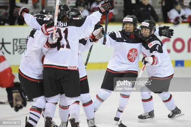 Rui Ukita of Japan celebrates scoring a goal with team mates during the Women's Ice Hockey Olympic Qualification Final game between Austria and Japan...