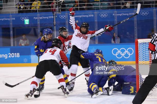 Rui Ukita of Japan celebrates with teammates after scoring a goal in the second period against Sweden during the Women's Ice Hockey Preliminary Round...