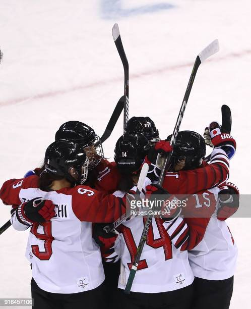 Rui Ukita of Japan celebrates with teammates after she scored during the Women's Ice Hockey Preliminary Round, Group B match between Japan and Sweden...