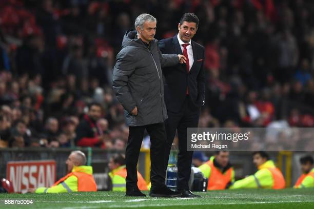 Rui Vitoria of Benfica and Jose Mourinho, Manager of Manchester United during the UEFA Champions League group A match between Manchester United and...