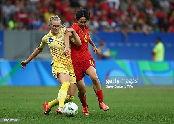Rui Zhang of China PR and Magdalena Eriksson of Sweden challenge for the ball during the Women's First Round Group E match between China PR and...