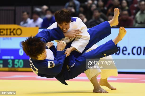 Ruika Sato of Japan competes against Mami Umeki of Japan in the Women's 78kg Bronze Final during day two of the Judo Grand Slam Tokyo at Tokyo...