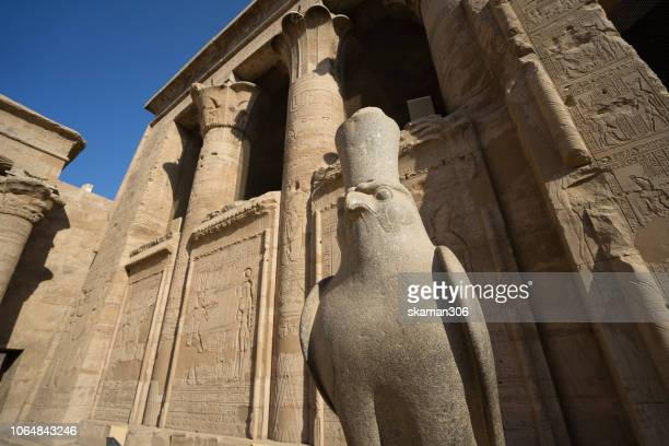 ruin stone carving god horus and osiris at edfu temple near nile river unesco site egypt - arthur stock pictures, royalty-free photos & images